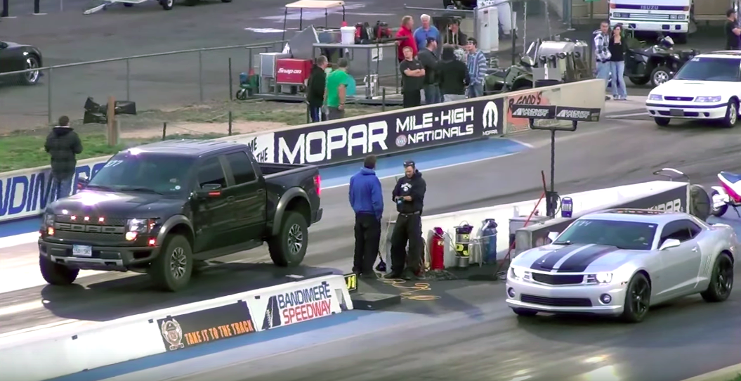Watch a Ford Raptor take on a Camaro SS