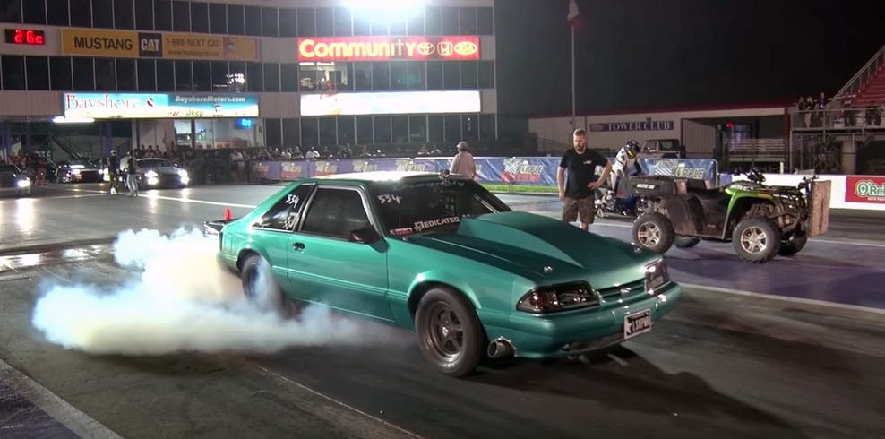 Bright teal Fox Mustang sends 1,400 horsepower down the strip