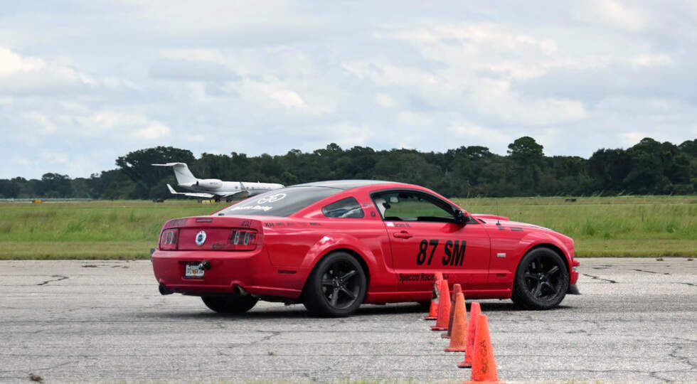 Tuned Mustang drifts and burns out in slow motion
